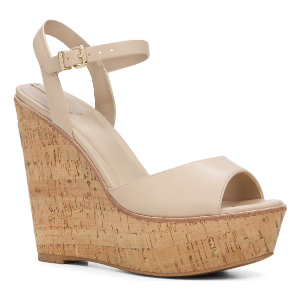 ALDO Aralinna - Pop the cork in this '70s- inspired wedge. From flared...