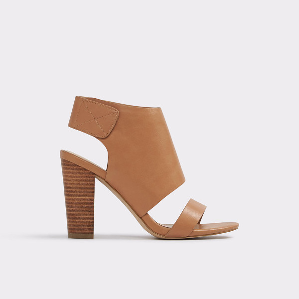 ALDO Mukai - Wide leather-like strap and blocky heel play with scale to...