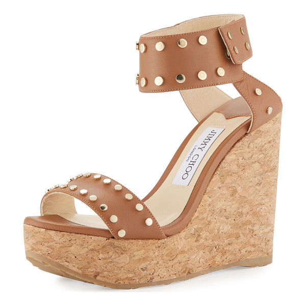 """JIMMY CHOO Nelly Studded Cork Wedge Sandal - Jimmy Choo leather sandal with golden studded trim. 4.7""""..."""