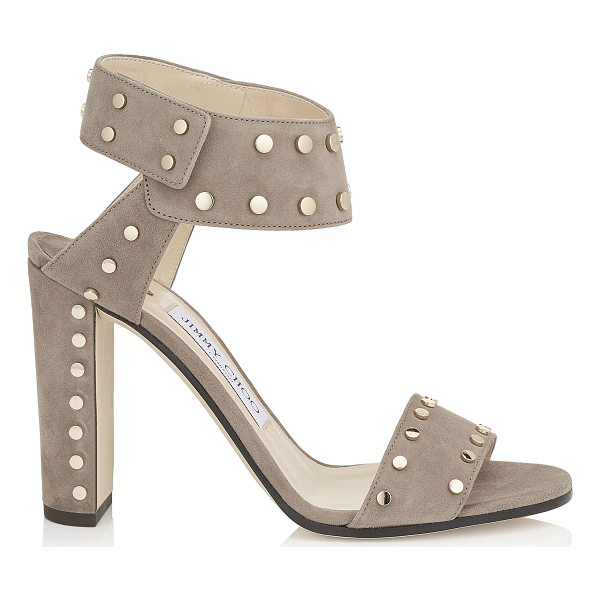 JIMMY CHOO VETO 100 Light Mocha Suede Sandals with Gold Studs - Clean, linear lines are injected with personality via a...