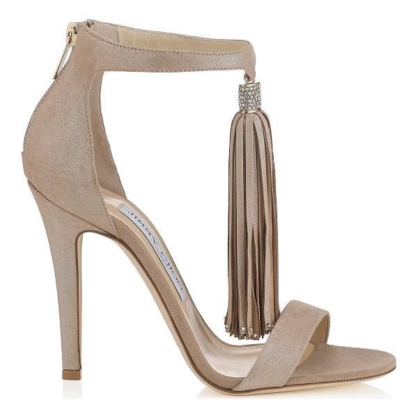 JIMMY CHOO VIOLA 110 Nude Shimmer Suede Sandals with a Nude Shimmer Suede Tassel - A simple modern silhouette that is accented with the a...