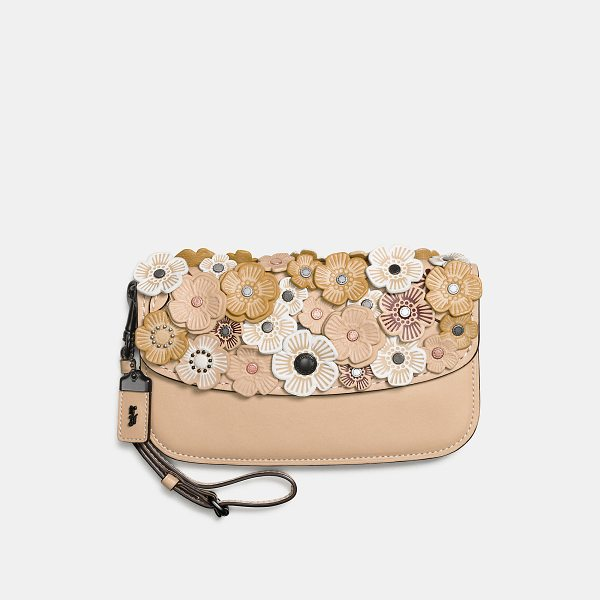 COACH clutch with tea rose - Wristlet and clutch in one, this portable piece is crafted...