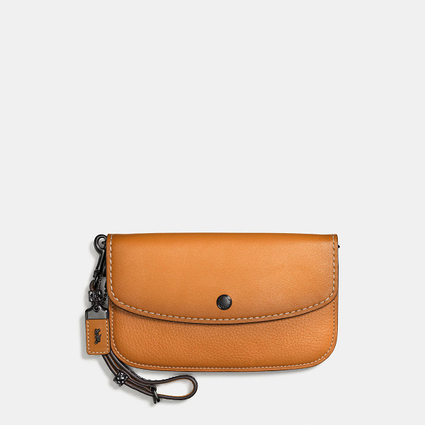 COACH clutch with colorblock snakeskin handle - Rich burnishing and a genuine snakeskin handle elevate our...