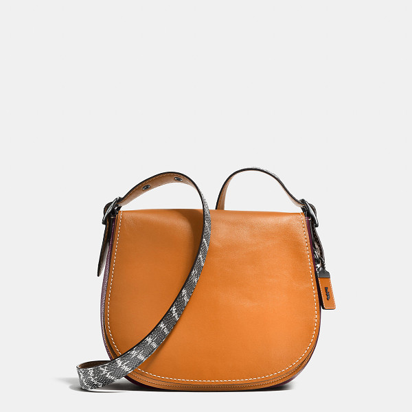 COACH saddle bag with colorblock snake detail - A genuine snakeskin strap adds luxe texture to our iconic...