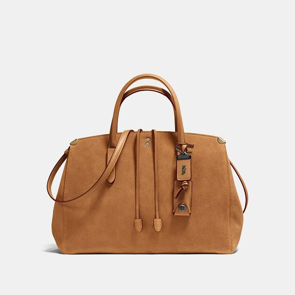 COACH cooper carryall - A lariat tie and polished metal corner accents give the...