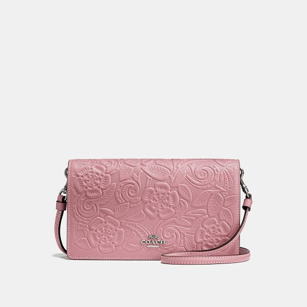 COACH foldover crossbody clutch with tea rose tooling - Easy, compact and practical-the perfect grab-and-go bag. A...