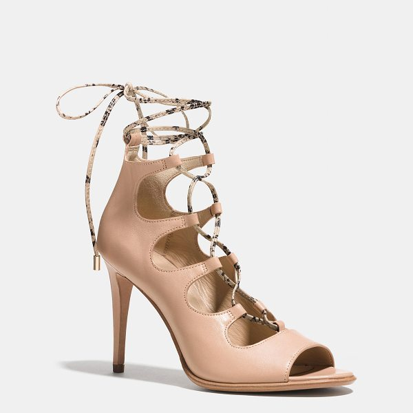 COACH kira heel - Stiletto heels and alluring cutouts add drama to a...