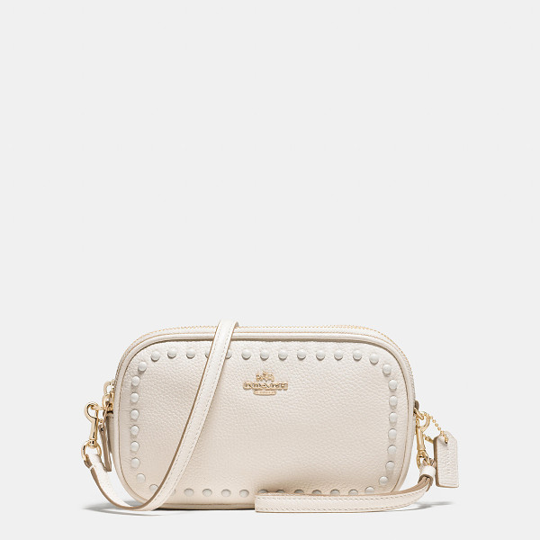 COACH lacquer rivets crossbody clutch - The rivets used for trains and platforms in the NYC subway...