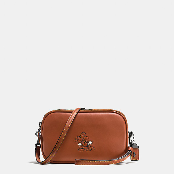 COACH mickey crossbody clutch - In this limited edition collection, Disney's Mickey Mouse...