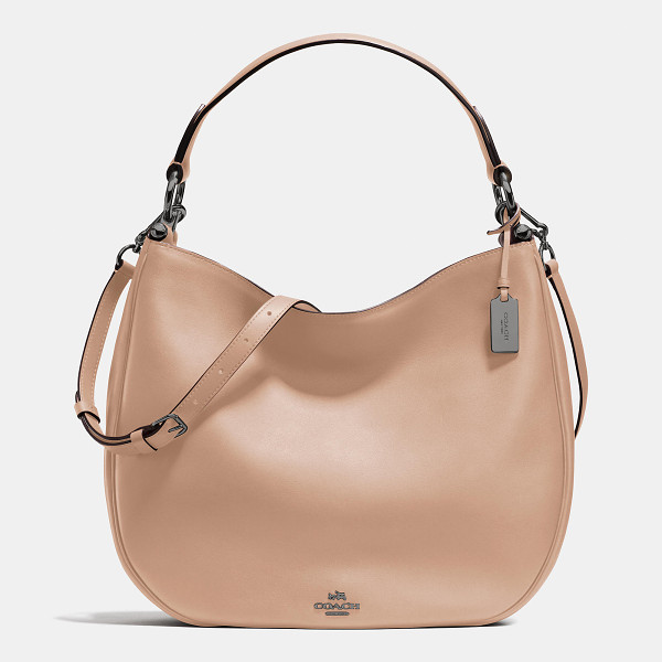 COACH nomad hobo - Soft and slouchy in supple glove-tanned leather, this...