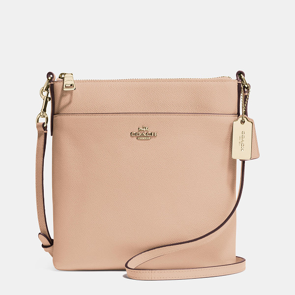 COACH north/south swingpack - Updated in embossed leather with a delicate yet durable...