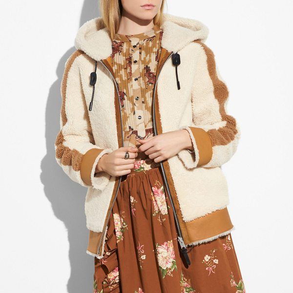 COACH reversible shearling hoodie - Playing with the juxtapositions of the great American...
