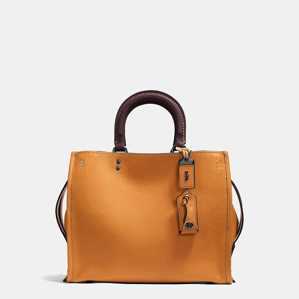 COACH rogue bag - Inspired by the Coach girl, the aptly named Rogue is...
