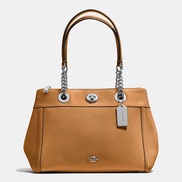 COACH turnlock edie carryall - Edie combines downtown ease with utility. An updated...
