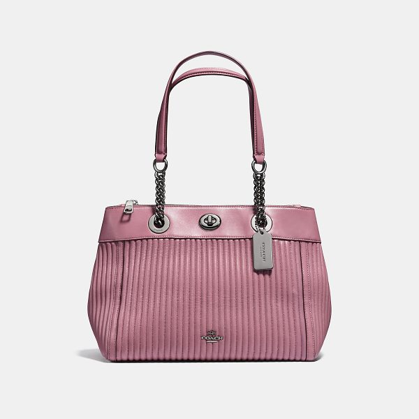 COACH turnlock edie carryall with quilting - Edie combines downtown ease with utility. An updated...