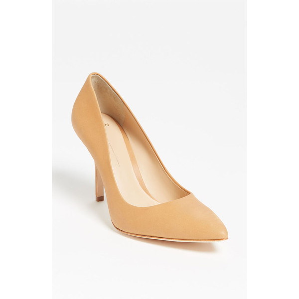 AERIN fira pump - A lovely almond-toe pump is cast in genuine snakeskin with...
