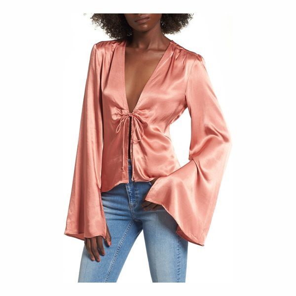 AFRM emma tie front top - A little retro, a lot racy, this fluid bell-sleeve blouse...