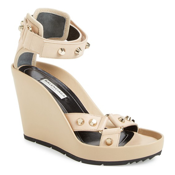 BALENCIAGA studded ankle strap wedge sandal - A sky-high sandal punctuated by signature flat-top studs...