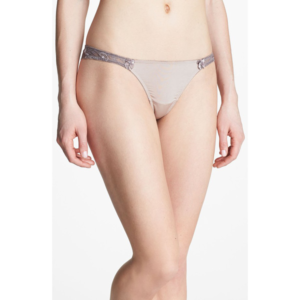 B.TEMPT'D BY WACOAL most desired thong - A waistband of lavish floral lace charms a barely there...