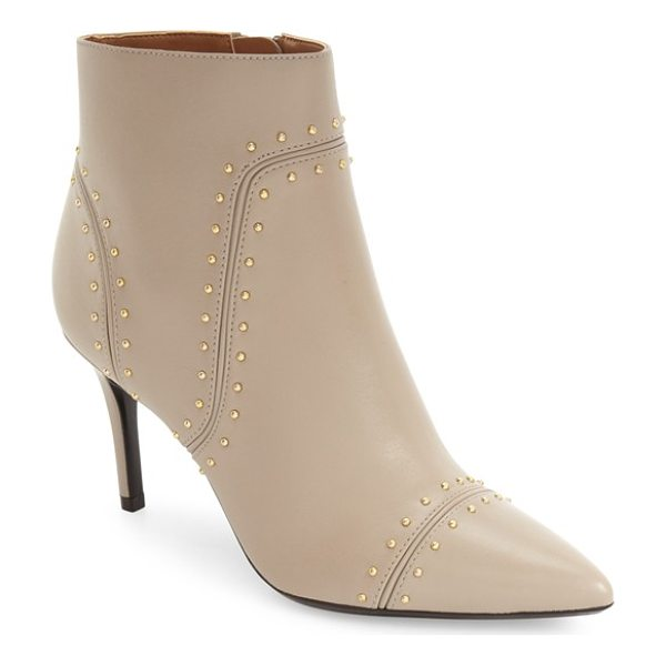 CALVIN KLEIN grazie studded pointy toe bootie - Tiny gleaming studs punctuate the seams of this...