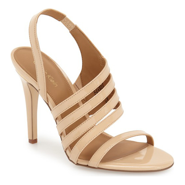 CALVIN KLEIN mirian sandal - Asymmetrical styling adds to the chic drama of a strappy...