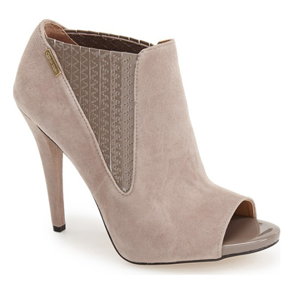 CALVIN KLEIN neive peep toe bootie - Glossy patent leather lends textural contrast at the peep...