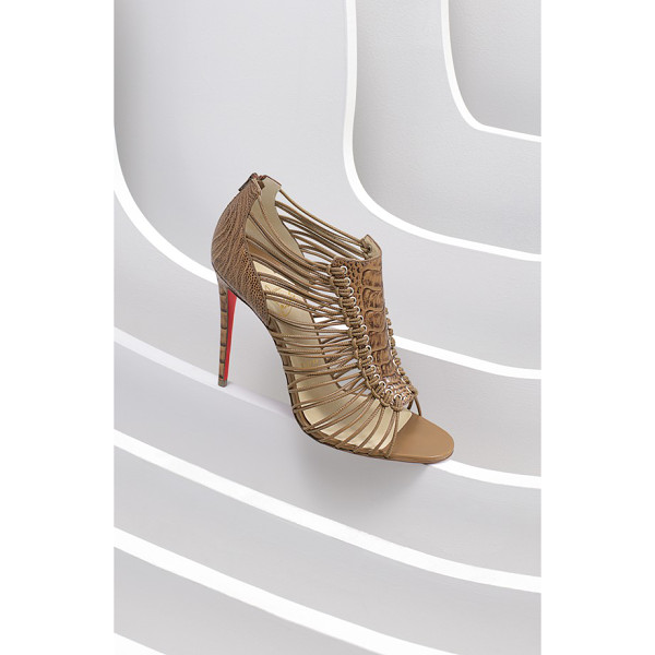 CHRISTIAN LOUBOUTIN amal ostrich leather sandal - Knotted cord straps secure the embossed shield detail on a...