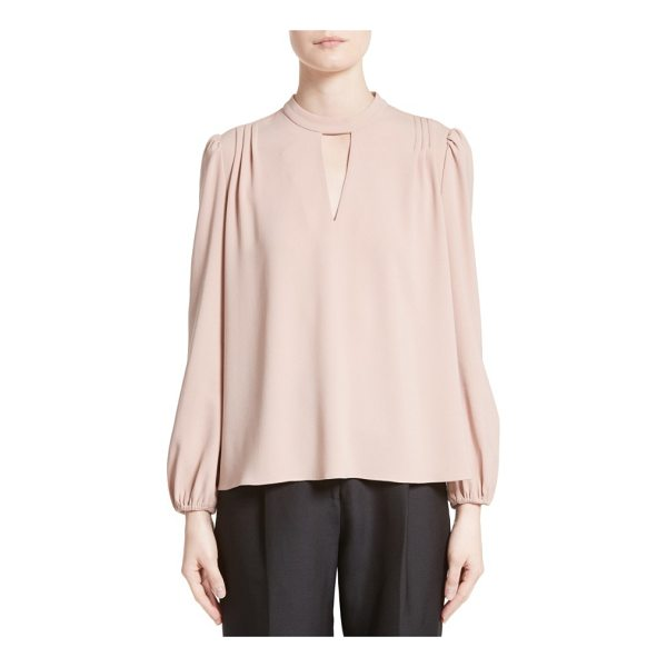 CO. crepe peasant blouse - Sewn from blush-hued crepe, this vintage-inspired blouse...