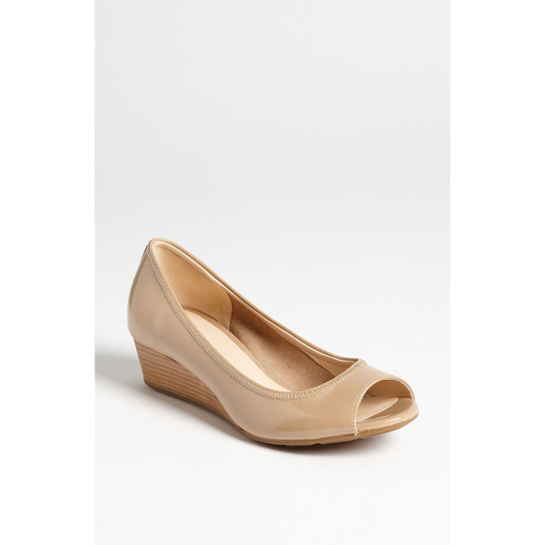 COLE HAAN air tali wedge - Timeless patent cuts a demure profile on an open-toe wedge...