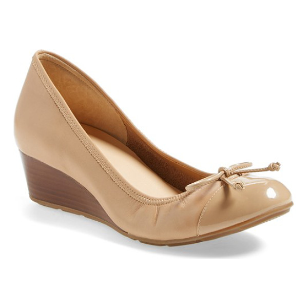COLE HAAN air tali wedge pump - A neat cap toe polishes the look of a pretty pump topped...