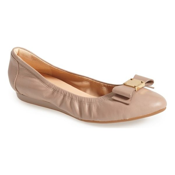 COLE HAAN 'tali' bow ballet flat - A sleek bow accented with logo-embossed goldtone hardware...