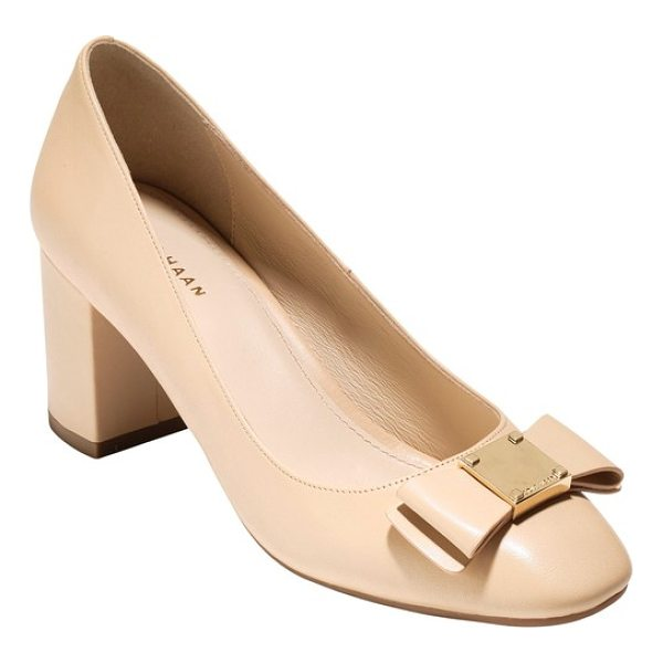 COLE HAAN tali bow pump - Gilded, logo-embossed hardware accentuates the structured...