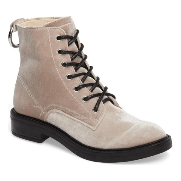 DOLCE VITA combat boot - A polished ring serves as the pull-on tab of a...