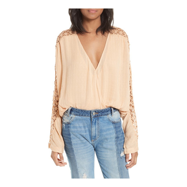 FREE PEOPLE runaway blouse - Channel your most bohemian persona in this nicely draped...