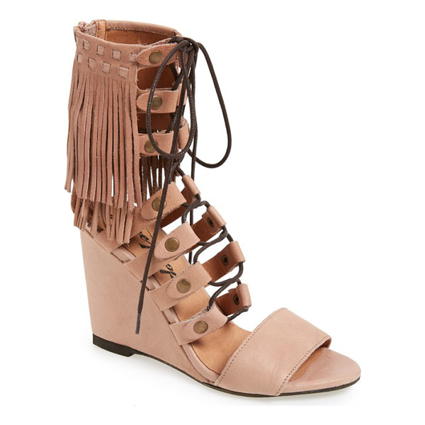 FREE PEOPLE solstice sandal - Layered fringe tops a chic lace-up sandal set on a covered...