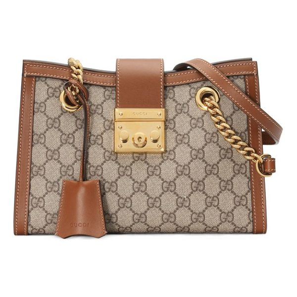 GUCCI small padlock gg supreme shoulder bag - A lock closure drawn from the Gucci archives is paired with...