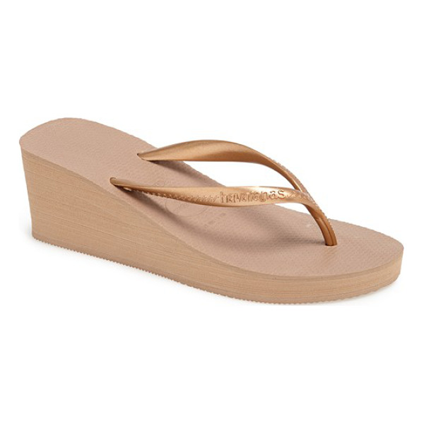 HAVAIANAS high fashion flip flop - A bold wedge heel adds chic style to a classic, versatile...