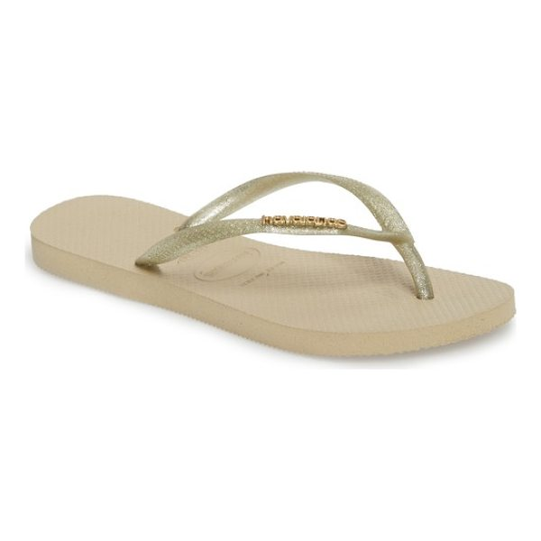 HAVAIANAS 'slim logo' metallic flip flop - Slender straps with a raised metallic logo ornament top a...