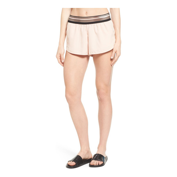 IVY PARK stripe elastic runner shorts - An illusion-style striped waistband gives a modern feel to...