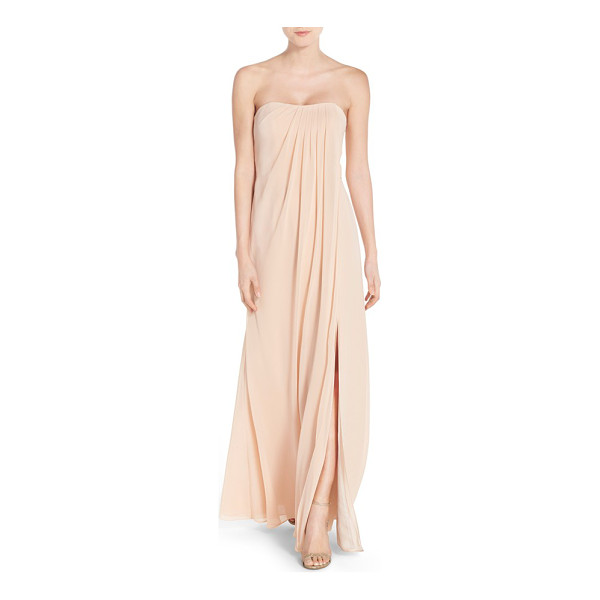 JENNY YOO 'raquel' front slit strapless chiffon gown - A swathe of precisely pleated chiffon flows from the...