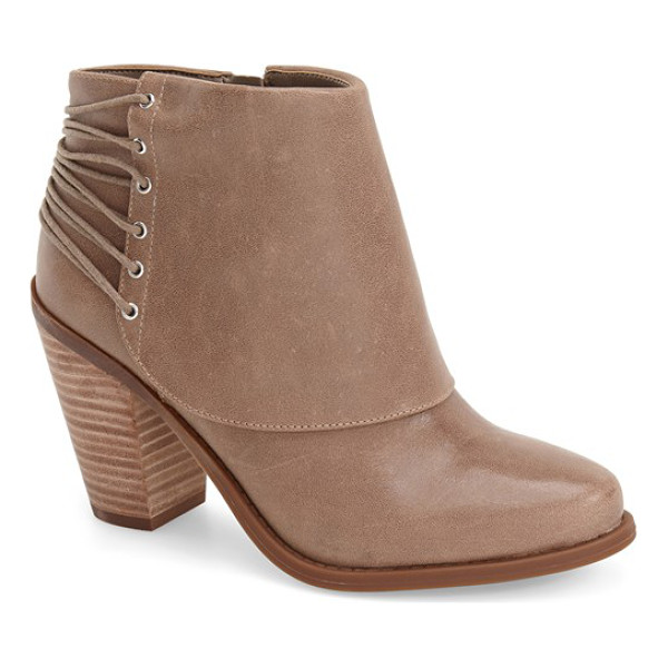 JESSICA SIMPSON calvey bootie - Skinny laces wrap the back of a leather shield bootie set...