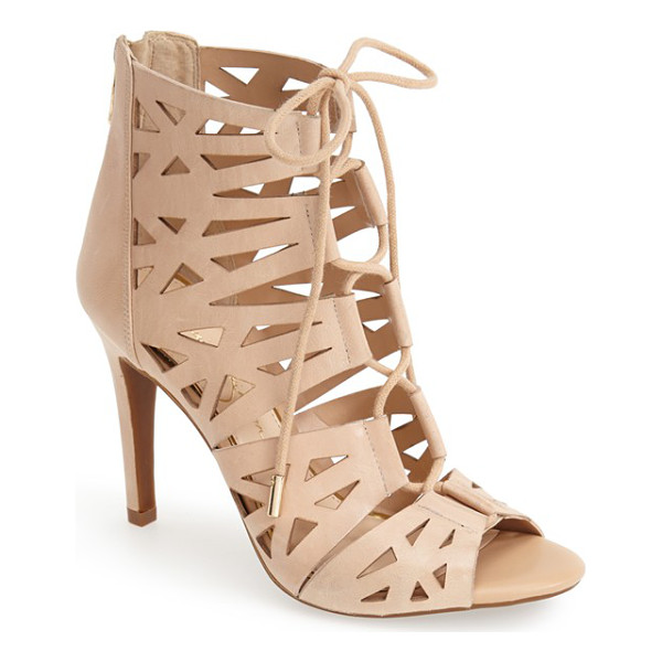 JESSICA SIMPSON emerita laser cutout cage sandal - Crisscrossed laces bridge the open front of a modern...
