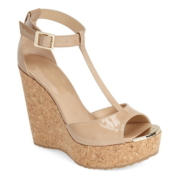 JIMMY CHOO 'pela' cork wedge sandal - Embossed goldtone hardware adorns the toe of a fierce