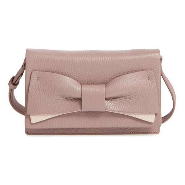 KATE SPADE NEW YORK Eden lane - A bow enhances the understated elegance of a compact bag...