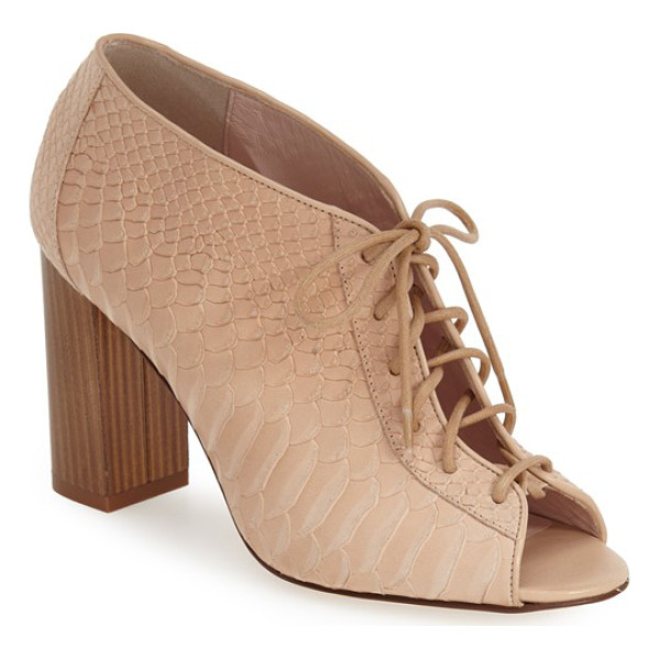 KATE SPADE NEW YORK inella lace-up bootie - Corset-style lacing and a chunky, vertical woodgrain heel...