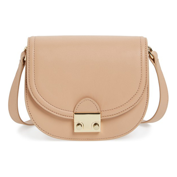 LOEFFLER RANDALL leather saddle bag - A logo-etched push-lock closure secures a structured saddle...