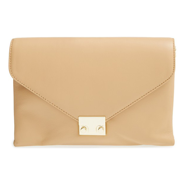 LOEFFLER RANDALL Lock clutch - Signature hardware finishes the neatly pointed flap of a...