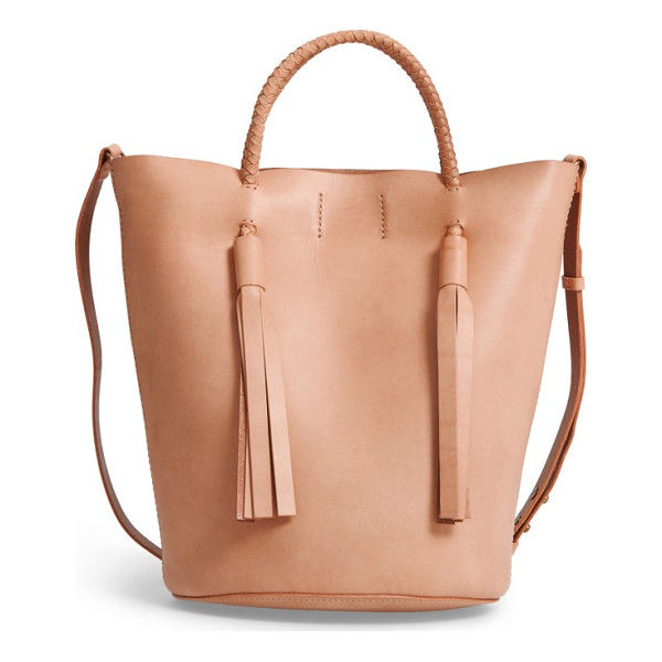MADEWELL austin leather bucket bag - Braided straps and dramatic tassels add textural intrigue...