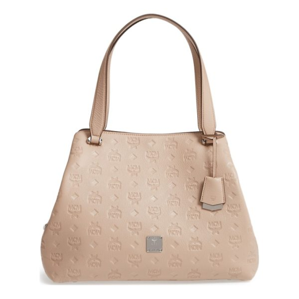 MCM signature monogrammed leather handbag - A roomy handlbag in logo-embossed leather features a trio...