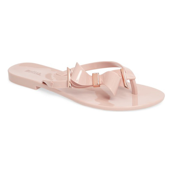 MELISSA harmonic make a wish jelly flip flop - An off-center bow tops the thong strap of a flexible,...